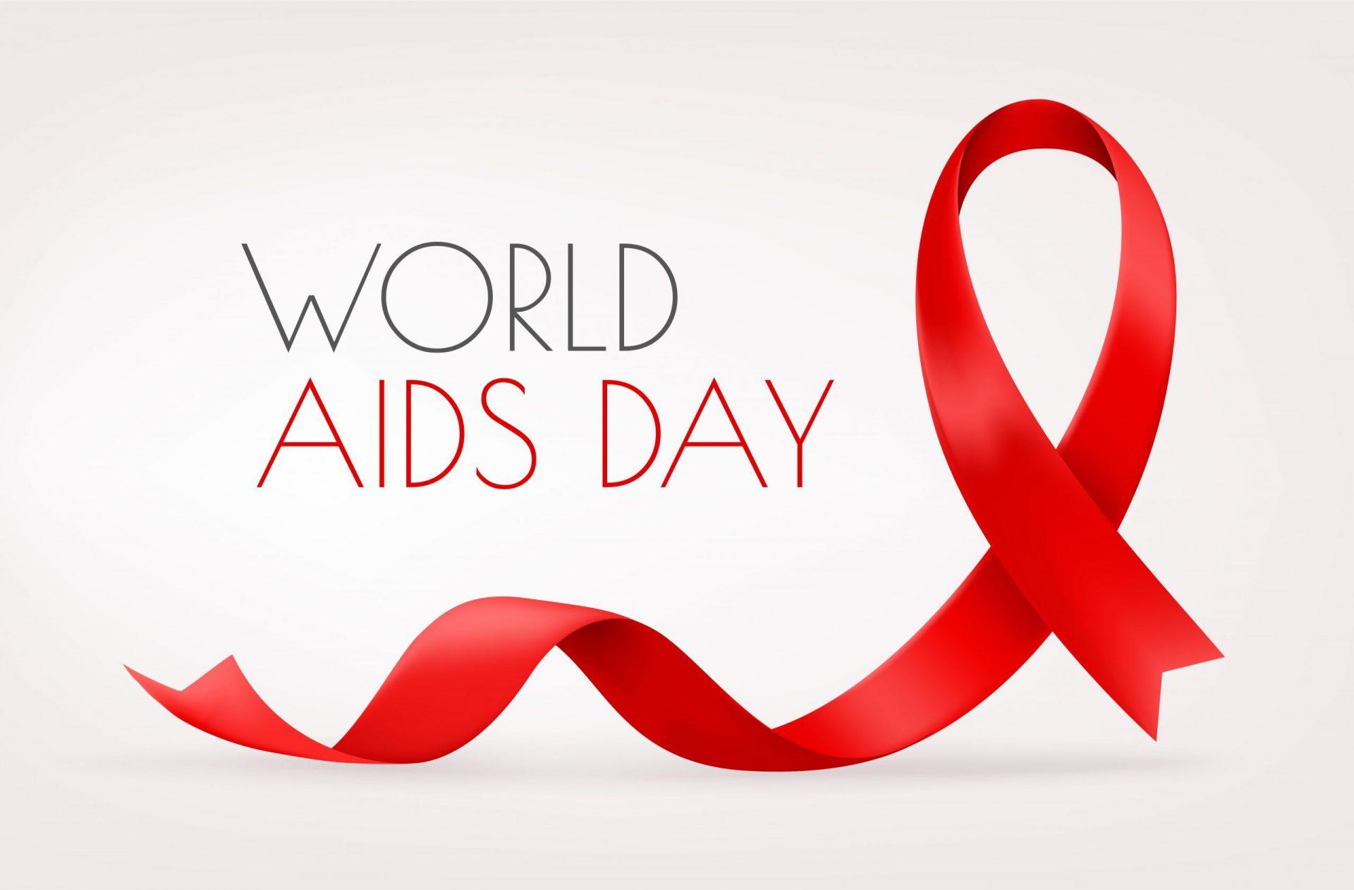 Schriftzug World Aids Day mit roter Schaufe